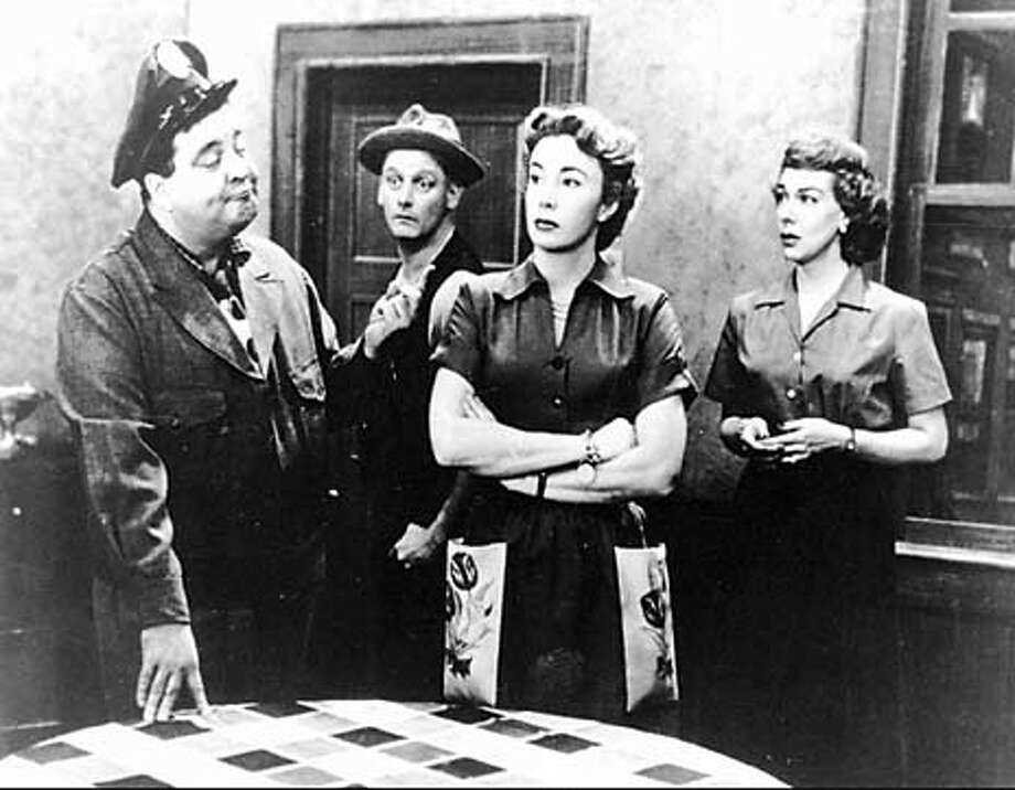"""FILE -- , second from right, is pictured in character as Alice Kramden on the classic television show """"The Honeymooners"""" in this undated file photo. Meadows, who as Alice played one of television's strongest, most spirited wives, died of cancer Saturday night, Feb. 3, 1996, a spokeswoman said Sunday, Feb. 4, 1996. She was 71. Pictured are, from left: Jackie Gleason as Ralph Kramden; Art Carney as Ed Norton; Meadows; and Joyce Randolph as Trixie Norton. (AP Photo/file) ALSO RAN: 08/30/1999, 10/10/02"""
