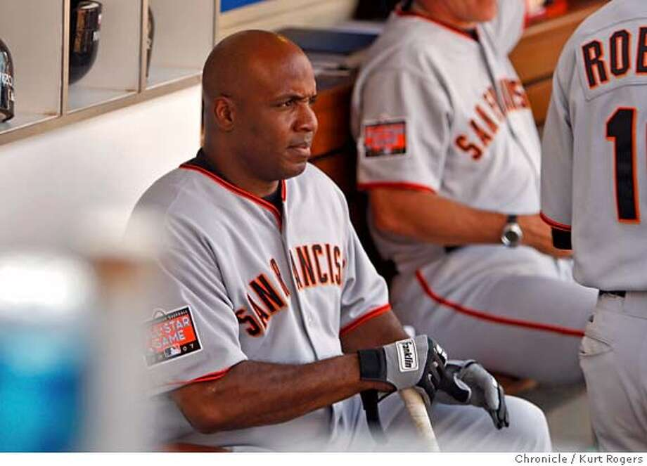 Barry Bonds with bat in hand watches the 9th inning.  San Francisco Giants vs.San Diego Padres SATURDAY, AUG 4, 2007 KURT ROGERS SAN DIEGO SFC  THE CHRONICLE GIANTS_0140_kr.jpg MANDATORY CREDIT FOR PHOTOG AND SF CHRONICLE / NO SALES-MAGS OUT Photo: KURT ROGERS