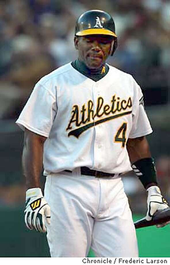 athletics2_054_FL.jpg  Athletics Miguel Tejada is unhappy with his at bat in the fourth inning. The Oakland Athletics play the Boston Red Sox in Game 5 of the American League Division Series at Oakland Coliseum 10/6/03 in Oakland. Frederic Larson / The Chronicle MANDATORY CREDIT FOR PHOTOG AND SF CHRONICLE/ -MAGS OUT Photo: Frederic Larson