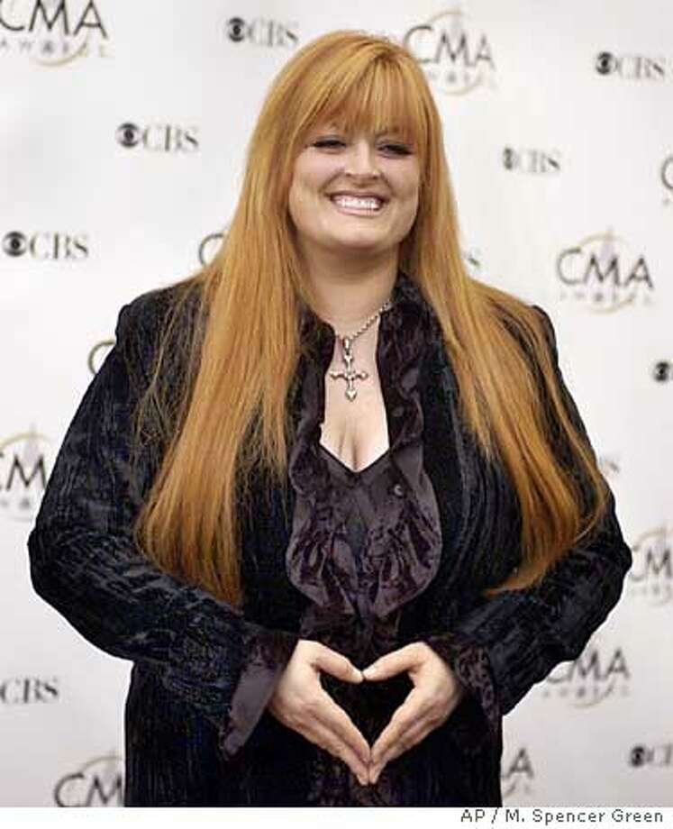 Wynonna Judd arrives for the 37th annual Country Music Association Awards show in Nashville, Tenn. on Wednesday, Nov. 5, 2003. Judd said the necklace she is wearing belonged to the late Johnny Cash. (AP Photo/M. Spencer Green) Photo: M. SPENCER GREEN