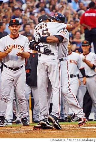 San Francisco Giants Barry Bonds hits homerun #755 in the 2nd inning.  He hugs his son Nikilai at home plate.  The San Diego Padres host the San Francisco Giants at Petco Park in San Diego on Saturday, August 4, 2007. Photo taken on 8/4/07 in San Diego, CA  Photo by Michael Maloney / San Francisco Chronicle  ***Roster/code replacement Photo: Michael Maloney