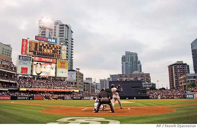 San Francisco Giants' Barry Bonds watches the flight of his home run, his 755th, during the second inning of their Major League Baseball game against the San Diego Padres in San Diego, Saturday, Aug. 4, 2007. With the hit, Bonds caught Hank Aaron and tied the career home run record. (AP Photo/ Kevork Djansezian,Pool) Photo: Kevork Djansezian