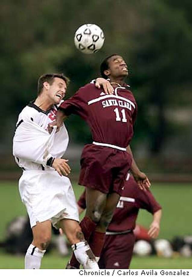 SOCCER26A-25NOV01-SP-CG --- Stanford's Lee Morrison, 24, and Santa Clara Univeristy's Jamil Walker, 11, go for the ball on a Santa Clara corner kick in the second half of play near the Stanford goal as Stanford held a 3-1 lead to beat the Broncos at Stanford University on Sunday, November 25, 2001, in the second round of NCAA mens' soccer College Cup. (Photo by Carlos Avila Gonzalez/The San Francisco Chronicle) Photo: CARLOS AVILA GONZALEZ
