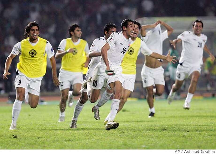 Iraq' Younis Kahlef (10) and teammates celebrate just after defeating Saudi Arabia 1-0 at their AFC Asian Cup soccer final match at Gelora Bung Karno Stadium in Jakarta, Indonesia, Sunday, July 29, 2007. (AP Photo/Achmad Ibrahim). Photo: Achmad Ibrahim