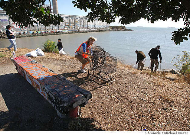 Anne Sjahsam of SF joins dozens of volunteers as they cleaned the park grounds and shoreline. Warm Water Cove is a park on the southern waterfront of San Francisco that doesn�t get much traffic from tourists, or even San Franciscans. It does have a devoted group of regulars, however � dog walkers, musicians who enjoy the acoustics, and graffiti artists who have transformed walls into a cacophony of scribblings and images. It�s the graffiti that has led to a battle in the park on the far edge of the Dogpatch neighborhood. The city plans to provide volunteers with buckets and paintbrushes Saturday to whitewash the walls as part of a broader attempt to make the park a cleaner place where someone might want to bring a family. Photographed in, San Francisco, Ca, on 8/4/07. Photo by: Michael Macor/ The Chronicle Photo: Michael Macor