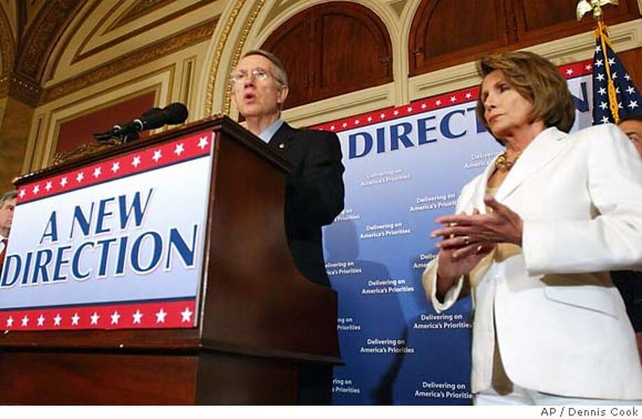 Senate Majority Leader Harry Reid of Nev., left, accompanied by House Speaker Nancy Pelosi of Calif., speaks during a news conference on Capitol Hill in Washington, Friday, Aug. 3, 2007. (AP Photo/Dennis Cook) Photo: Dennis Cook