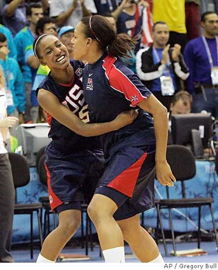 U.S. Candice Wiggins, left, and Marissa Coleman celebrate after beating Brazil during a Pan American Games gold medal basketball game against Brazil in Rio de Janeiro, Tuesday, July 24, 2007. U.S. beat Brazil to win the gold medal in the game. (AP Photo/Gregory Bull) EFE OUT BRAZIL OUT Photo: Gregory Bull
