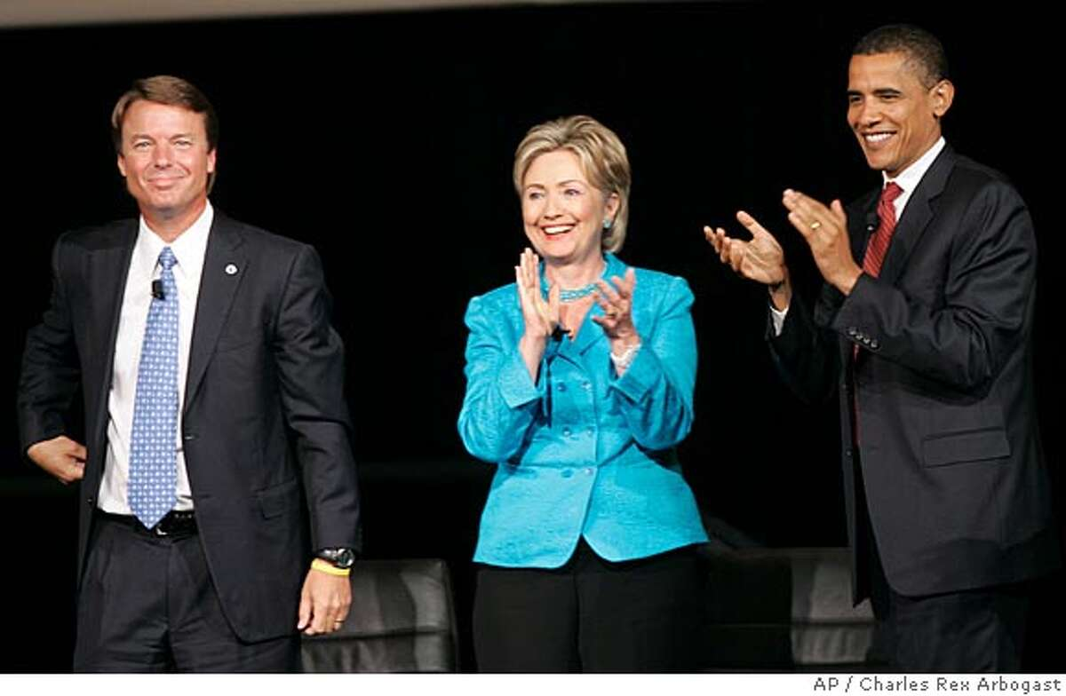 Democratic presidential candidates former Sen. John Edwards, left, Sen. Hillary Rodham Clinton, D-N.Y., center, and Sen. Barack Obama, D-Ill., look out over the crowd after they participated in the Yearly Kos Convention's Presidential Leadership Forum in Chicago, Saturday, Aug. 4, 2007. (AP Photo/Charles Rex Arbogast)