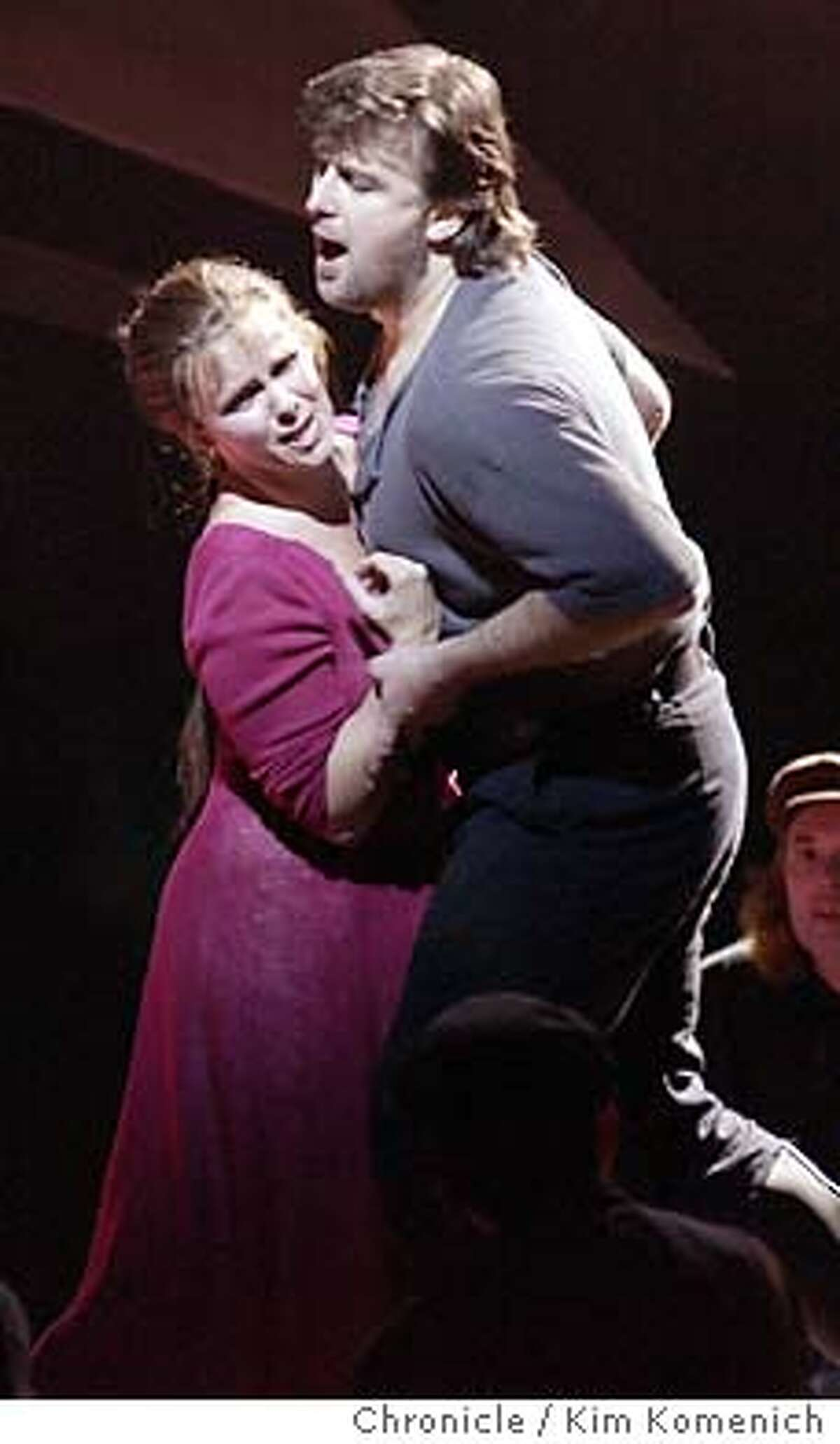 11/6/03 in San Francisco. San Francisco Opera presents Lady Macbeth of Mtsensk. Katerina (Solveig Kringelborn) accepts a challenge from Sergei (Christopher Ventris) to prove her strength. KIM KOMENICH / The Chronicle