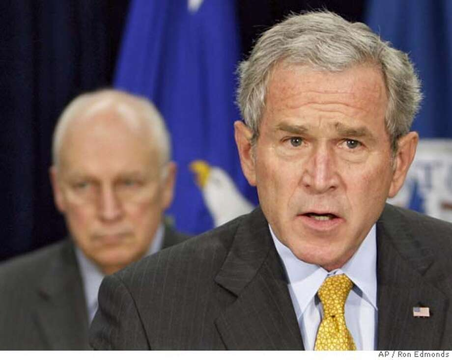 President Bush, right, accompanied by Vice President Dick Cheney, makes comments after meeting with the Counterterrorism Team, Friday, Aug. 3, 2007, at the J. Edgar Hoover FBI Building in Washington. (AP Photo/Ron Edmonds) Photo: Ron Edmonds