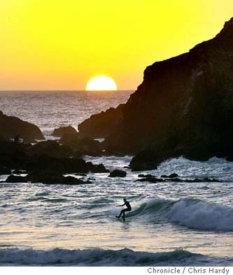 Sunset at Rockaway beach in Pacifica with surfers, and fisherment and tourists  11/10/03 in Pacifica. CHRIS HARDY / The Chronicle Photo: CHRIS HARDY