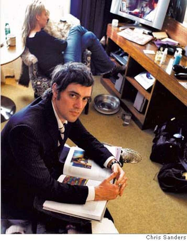 That�s his girl Teresa in the background, who committed suicide the week before. Really tells a poignant story at this point� Here�s the caption:  Portrait of Blake, March 2004; Courtesy Feigen Contemporary, New York; photo credit: Chris Sanders Photo: Chris Sanders