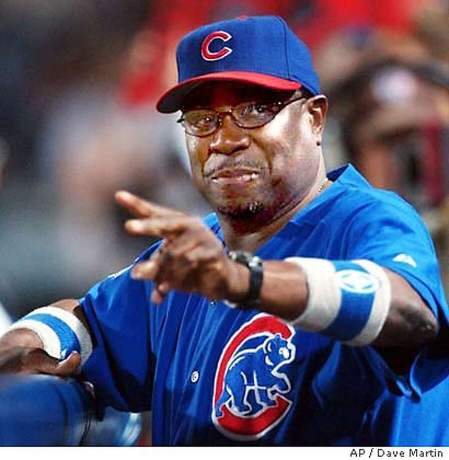 Chicago Cubs manager Dusty Baker gestures from the dugout in game five of the National League Division Series at Turner Field in Atlanta Sunday, Oct. 5, 2003 . (AP Photo/Dave Martin) Photo: DAVE MARTIN