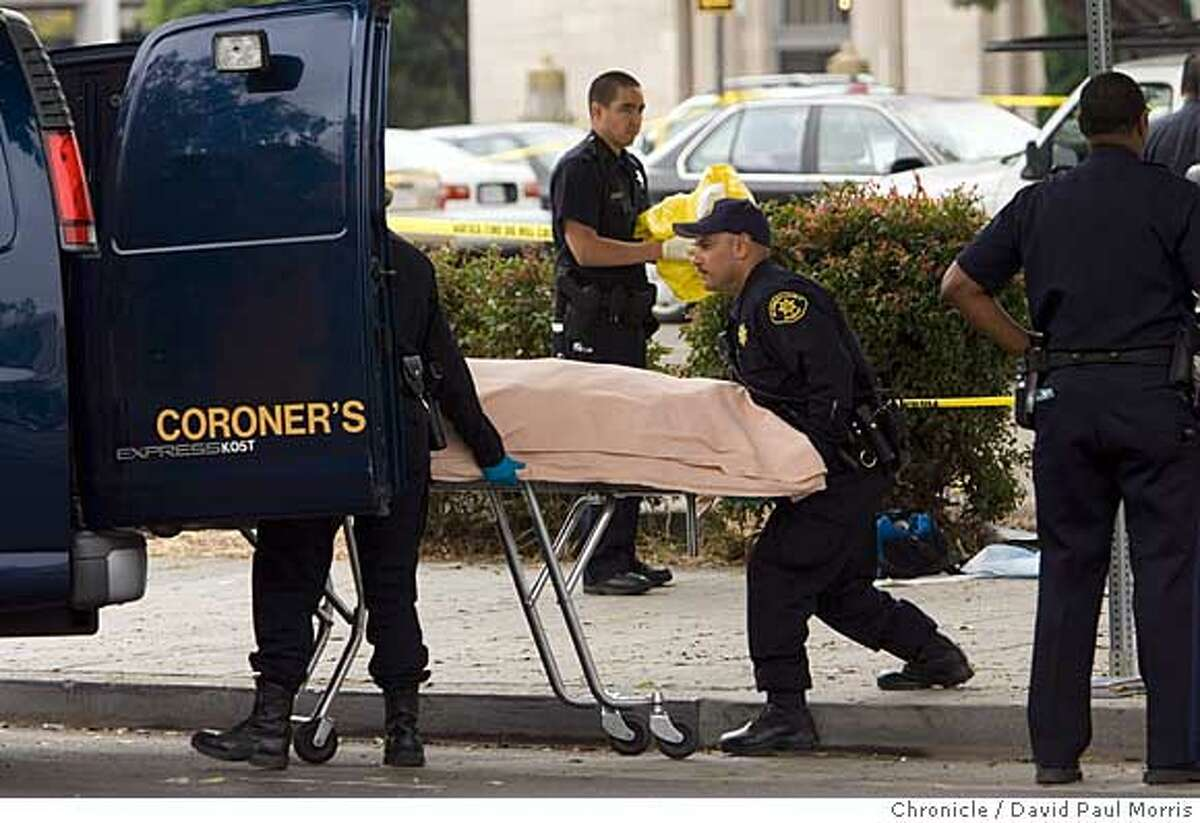 OAKLAND, CA - AUG 2: Coroners put the body or Chauncey Bailey, 58 into the back of the van on August 2, 2007 in Oakland, California. Bailey, the editor of the Oakland Post, was gunned down on 14th street in downtown Oakland in the early morning hours as he was walking to work. (Photo by David Paul Morris / The Chronicle)