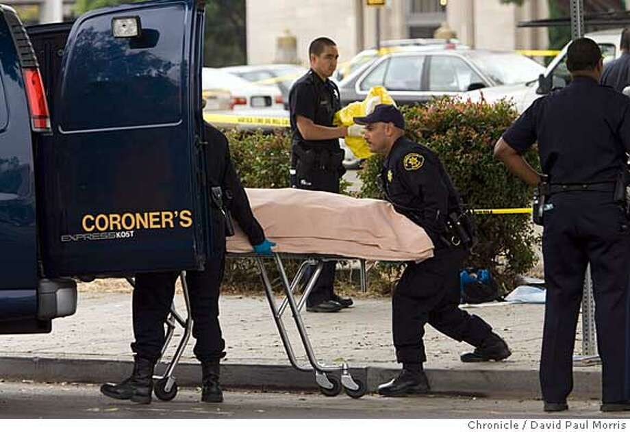 OAKLAND, CA - AUG 2: Coroners put the body or Chauncey Bailey, 58 into the back of the van on August 2, 2007 in Oakland, California. Bailey, the editor of the Oakland Post, was gunned down on 14th street in downtown Oakland in the early morning hours as he was walking to work. (Photo by David Paul Morris / The Chronicle) Photo: David Paul Morris
