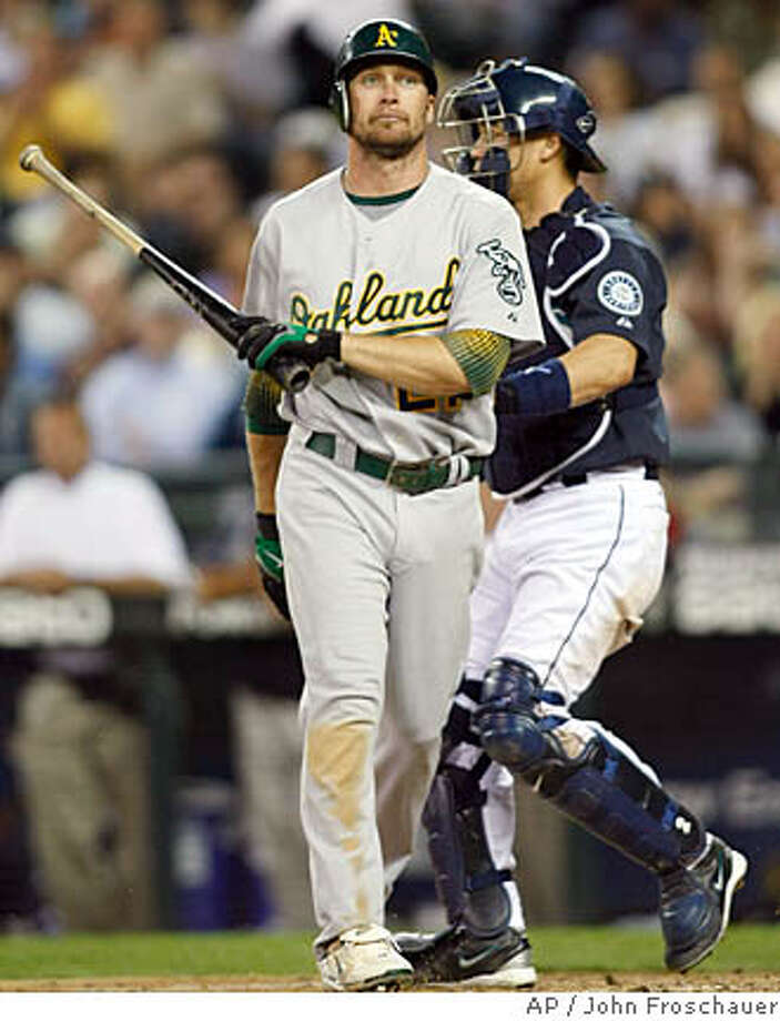 Oakland Athletics' Mark Kotsay reacts after striking out to Seattle Mariners pitcher Brandon Morrow during the ninth inning of a baseball game Friday, July 27, 2007, in Seattle. At right is Seattle catcher Kenji Johjima. The Mariners won 7-1. (AP Photo/John Froschauer) Photo: John Froschauer