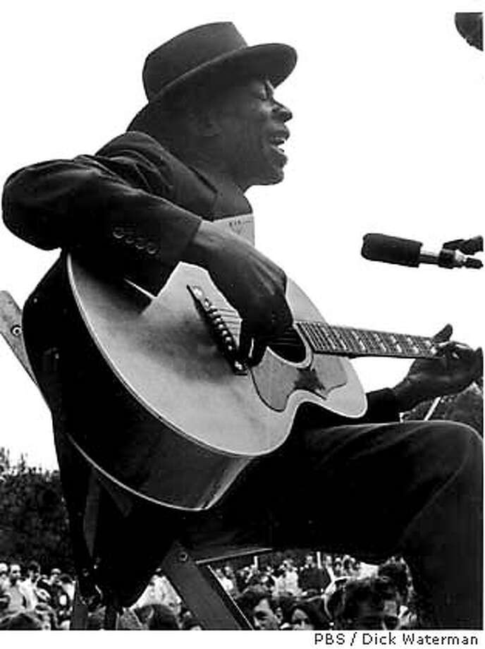 For BLUES21, datebook, selvin ; [Featured in �The Soul of a Man�] Skip James� performance at the Newport Folk Festival (pictured here) in 1964 raised him out of obscurity and into blues history with the delivery of his haunting falsetto and unique guitar style. An influence to Robert Johnson, James was considered by some to be �The Greatest Blues man of the Delta.� Photo Credit: � Dick Waterman ; on 6/10/03 in . Dick Waterman / PBS Photo: Dick Waterman