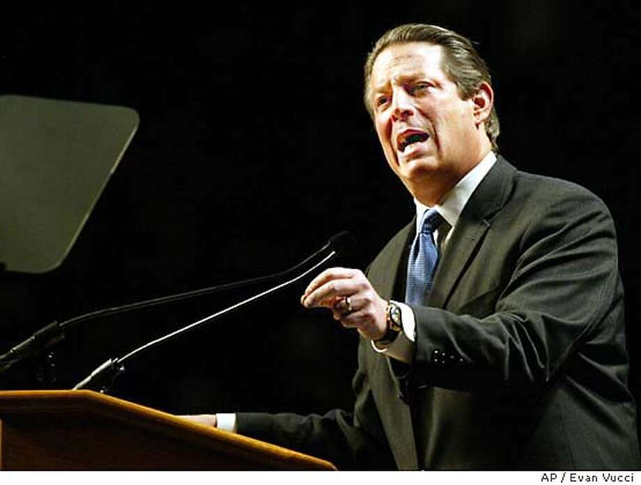 Former Vice President Al Gore gestures during a speech on Sunday, Nov. 9, 2003 in Washington. Gore charged Sunday that the Bush administration has failed to make the country safer after the Sept. 11 attacks and is using the anti-terrorism fight as a pretext to consolidate political power. (AP Photo/Evan Vucci) Photo: EVAN VUCCI