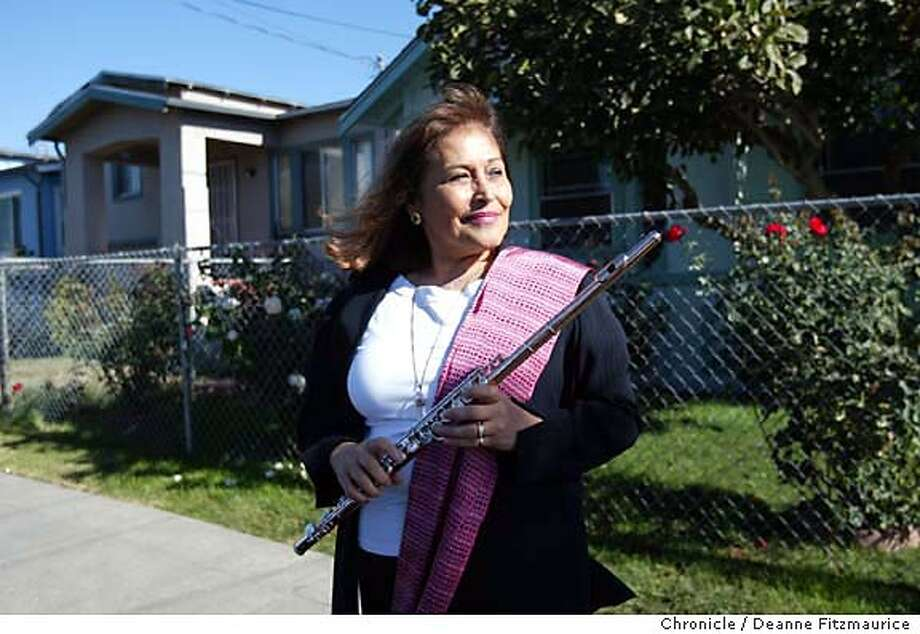 duran_024_df.JPG Elena Duran, flutist who will be performing at Oakland East Bay Symphony is from the Bay area and visits the East Oakland neighborhood where she grew up. Her grandmother's house is behind her at right.  Shot on 10/8/03 in Oakland.  DEANNE FITZMAURICE / The Chronicle Photo: DEANNE FITZMAURICE