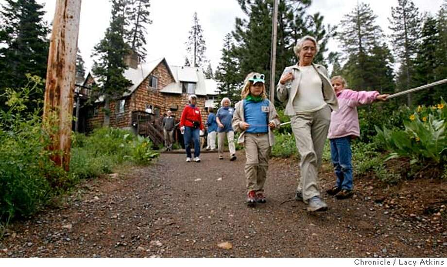 The group camping at the Clair Tappaan Lodge take an evening hike, Wednesday June 28, 2006, in Nordan, Ca.The Sierra Club has owned an operated a large, rambling, rustic lodge in Sierra for 70 years. Clair Tapaan Lodge has been used for conferences, for family get-togethers, and to launch several generations of skiers and hikers. Now there is consternation that the lodge may be sold, since the Club must subsidize it to the tune of $100k per year - money that would be better spent on the Club's important legal and lobbying activities, June 28, 2006, in San Francisco, Ca. (Lacy Atkins/The Chronicle) Ran on: 07-06-2006  A group staying at Clair Tappaan Lodge goes hiking. The lodge's owner, the Sierra Club, says it must become profitable and more relevant or be closed or sold. MANDATORY CREDITFOR PHOTGRAPHER AND SAN FRANCISCO CHRONICLE/NO SALES-MAGS OUT Photo: Lacy Atkins