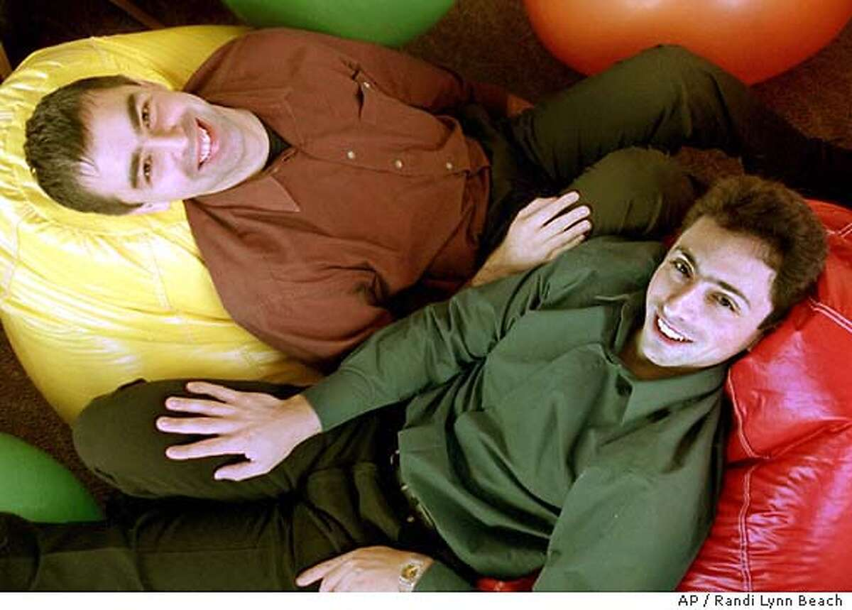 ** ADVANCE FOR SATURDAY AUGUST 2 -- FILE ** Google's co-founders, Larry Page, left, and Sergey Brin, rest on bean bags at Google's headquarters on Friday, Nov. 11, 2000, in Mountain View, Calif. It's been a whirlwind five years for online search engine Google, which has evolved from a nerdy college experiment to an Internet powerhouse so ubiquitious that its goofy name has become part of the English language. Now it looks like things are about to become even more interesting for a company that processes 200 million online search requests per day. Two formidable foes, Yahoo! Inc. and Microsoft Corp., are searching for ways to steal Google's thunder in a showdown that could reshape the way millions of people find their way around the Internet. (AP Photo/Randi Lynn Beach) Photo caption google_PH2973814400AP** ADVANCE FOR SATURDAY AUGUST 2 -- FILE ** Google's co-founders, Larry Page, left, and Sergey Brin, rest on bean bags at Google's headquarters on Friday, Nov. 11, 2000, in Mountain View, Calif. It's been a whirlwind five years for online search engine Google, which has evolved from a nerdy college experiment to an Internet powerhouse so ubiquitious that its goofy name has become part of the English language. Now it looks like things are about to become even more interesting for a company that processes 200 million online search requests per day. Two formidable foes, Yahoo! Inc. and Microsoft Corp., are searching for ways to steal Google's thunder in a showdown that could reshape the way millions of people find their way around the Internet. (AP Photo-Randi Lynn Beach)__CAT saturday layout for monday CAT saturday layout for monday