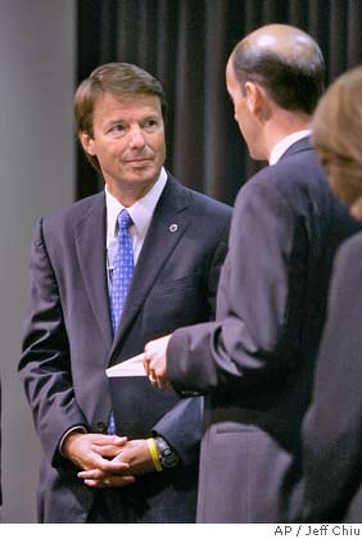 Democratic presidential hopeful John Edwards, left, speaks to members of the Silicon Valley Leadership Group on Wednesday, Aug. 1, 2007, in Santa Clara, Calif. (AP Photo/Jeff Chiu)
