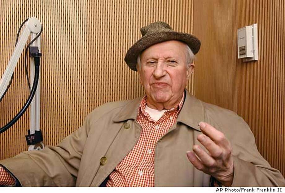 Oral historian Studs Terkel gestures while talking inside the first booth launched by StoryCorps for a national project, Thursday, Oct. 23, 2003 in New York's Grand Central Station. The master interviewer and author was on hand Thursday for the opening of an recording booth at New Yorks Grand Central Terminal, where for the next two years, people will be able to record and archive their memories and musings.(AP Photo/Frank Franklin II) Photo: FRANK FRANKLIN II