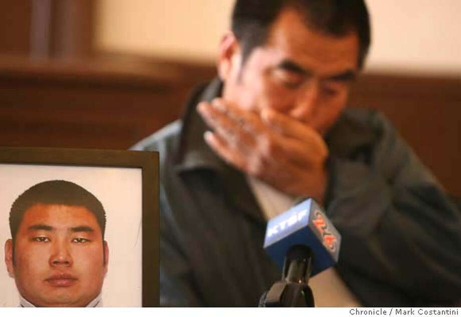 Huiquan Chang, 48, El Cerrito, weeps as he speaks about his son Jinzhou Chang(in the photo beside him), who was murdered as they were both working at an apartment building on Belmont St. in El Cerrito. Photo: Mark Costantini / S.F. Chronicle Photo: Mark Costantini