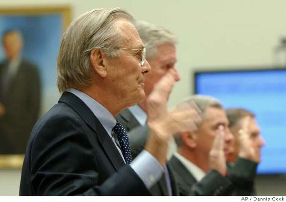 Former Defense Secretary Donald H. Rumsfeld, left, and others, are sworn in on Capitol Hill in Washington, Wednesday, Aug. 1, 2007, prior to testifying before the House Oversight and Government Reform Committee hearing to discuss the death of former football star and soldier Pat Tillman. From left are, Rumsfeld, former Joint Chiefs Chairman Richard Myers, retired Gen. John Abizaid and Gen. Bryan Douglas Brown. (AP Photo/Dennis Cook) Photo: Dennis Cook