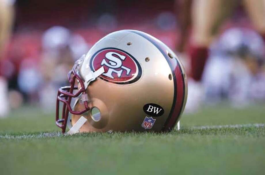 """NOTE - MUST USE THE WORDS ILLUSTRATION IN CAPTION. This illustration shows what the 49ers helmet will look like this season. The black """"BW"""" is a tribute to the recently deceased Bill Walsh -- legendary former head coach of the San Francisco 49ers. San Francisco 49ers / Courtesy to The Chronicle MANDATORY CREDIT FOR PHOTOG AND SAN FRANCISCO CHRONICLE/NO SALES-MAGS OUT Photo: Handout"""