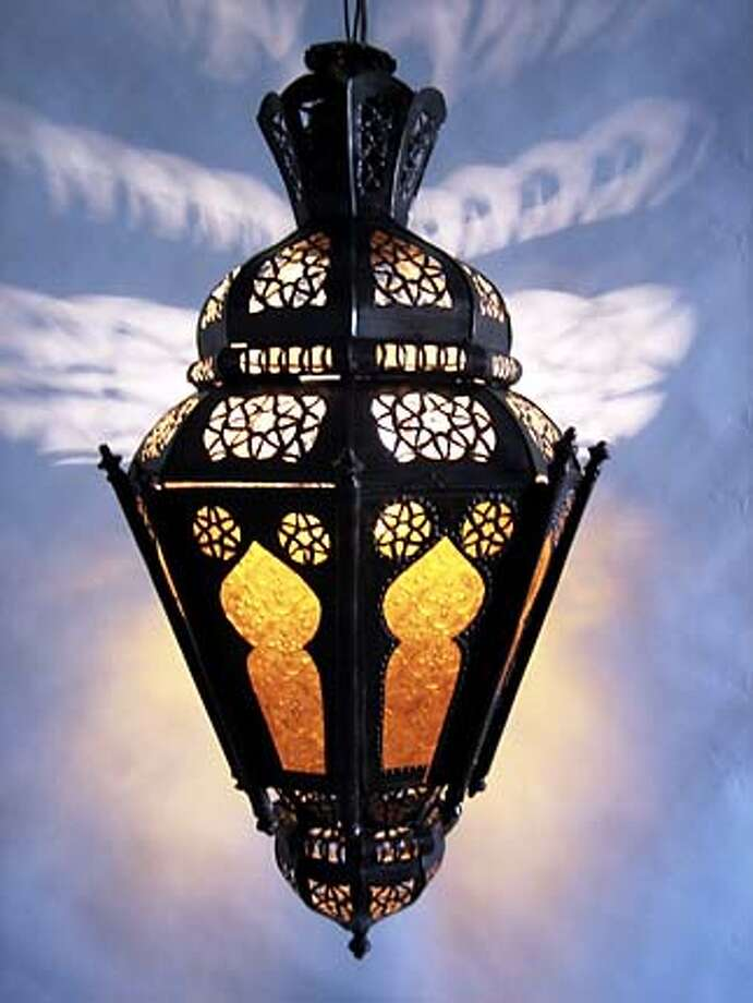 name:akwas  Material: Hand-carved tin and amber stained glass.  Wiring offered seperately  price: $150 Photo: Tazi Hicham