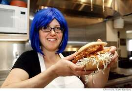 CHEF01_032_RAD.jpg  SHOWN: Betty, from Bakesale Betty, holding her famous fried chicken sandwich. Betty is the alter ego of Alison Barakat, who, with her husband Michael Camp, runs Bakesale Betty. Bakesale Betty is the name of the pie and sandwich shop in Oakland, CA. (Katy Raddatz/The Chronicle)  **Bakesale Betty, Alison Barakat, Michael Camp Mandatory credit for the photographer and the San Francisco Chronicle. No sales; mags out.