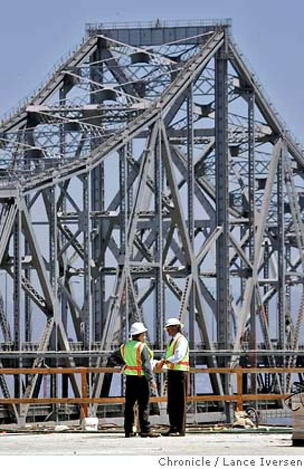 BAYBRIDGE01_53193.JPG  CalTrans employees stand on the new section of roadway that will replace the old section at the Treasure Island approach Labor Day weekend. CC Meyers Construction crews continues to work on the Bay Bridge Seismic Safety Project that will close both decks of the bridge for three days, 81 hours total over the Labor Day weekend when CalTrans will move a 350 ft section of roadway into place just east of the Treasure Island Tunnel. (July31) Lance Iversen/The Chronicle (cq) SUBJECT 7/31/07,in SAN FRANCISCO. CA. Photo: By Lance Iversen