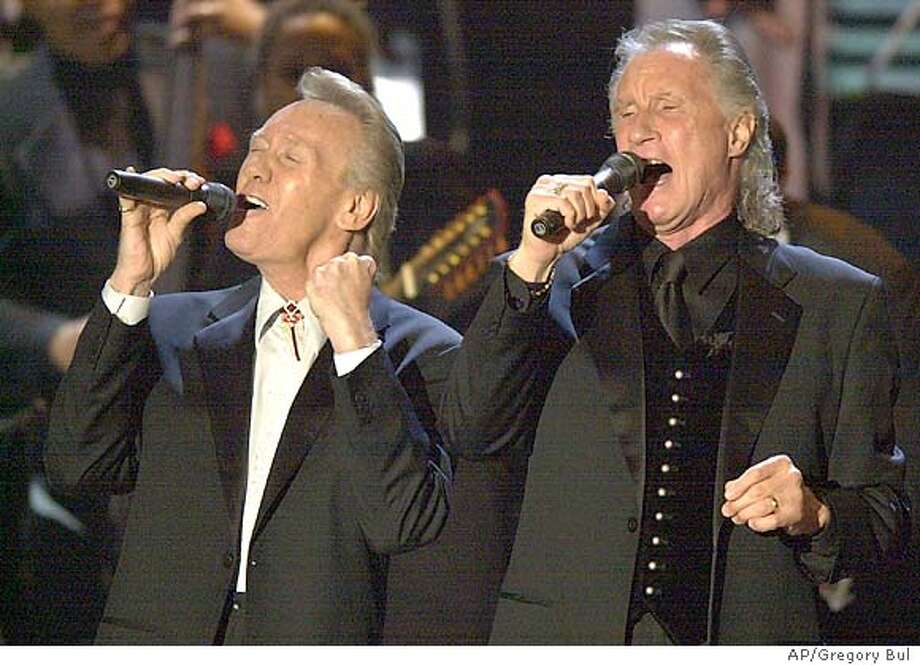 ** FILE ** The Righteous Brothers, Bobby Hatfield, left, and Bill Medley perform before being inducted into the Rock and Roll Hall of Fame during the 18th Annual induction ceremony in this March 10, 2003 file photo, at New York's Waldorf Astoria. Hatfield died Wednesday night, Nov. 5, 2003, of undetermined causes, his manager said. He was 63. (AP Photo/Gregory Bull, File) Photo: GREGORY BULL