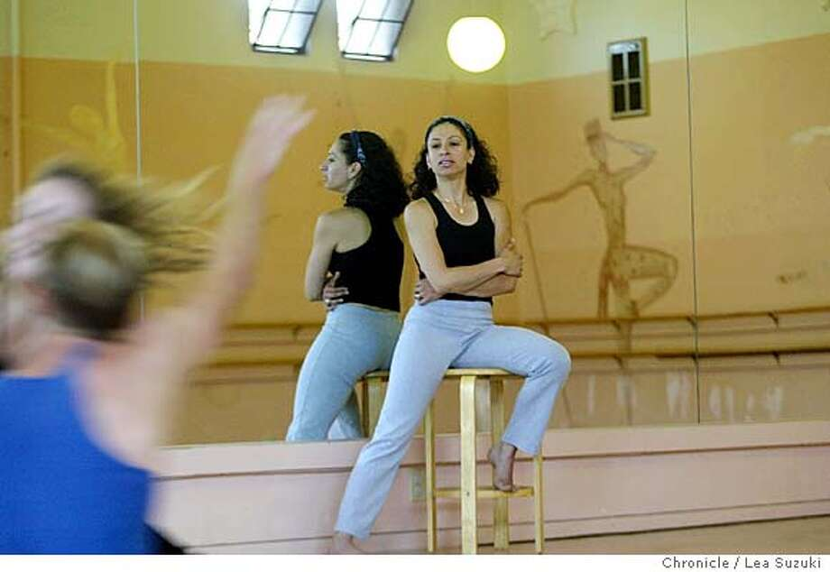 "Yasmen Sorab Mehta watches Will Elder-Groebe and Jamie Duggan rehearse ""Day and Dreams"". Mehta choreographs and fine tunes a piece titled ""Day and Dreams"" for the production ""It's a Sign"" on 10/19/03 in San Francisco, CA. Photo by Lea Suzuki/ The San Francisco Chronicle. Photo: Lea Suzuki"