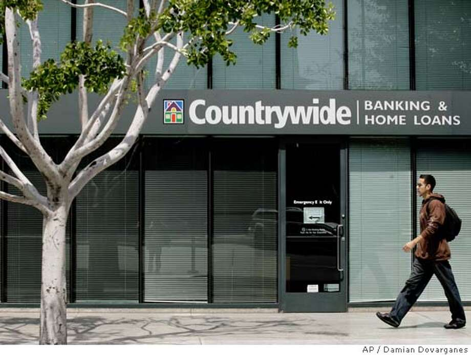 � **FILE** The Countrywide Banking and Home Loans office in Glendale, Calif. is seen in this April 26, 2007 file photo. Countrywide Financial Corp.'s profit shrank by nearly a third in the second quarter as a slumping housing market put pressure on the mortgage lender's customers, the company said Tuesday, July 24, 2007. (AP Photo/Damian Dovarganes, file) APRIL 26, 2007 FILE PHOTO Photo: Damian Dovarganes