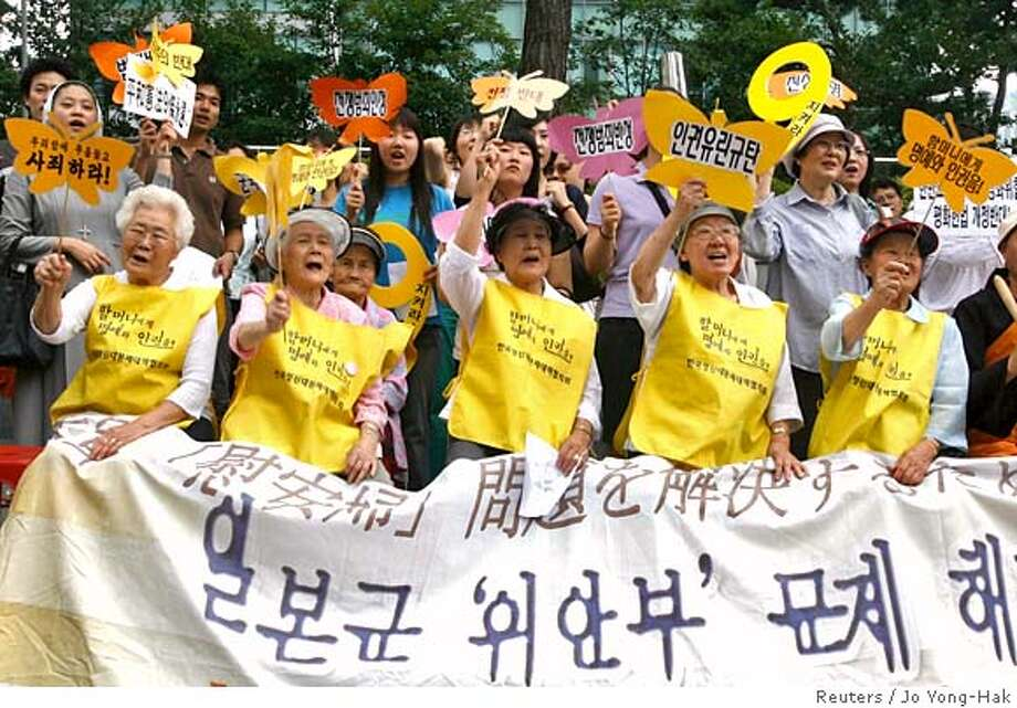 "Former South Korean comfort women (front row), who served the Japanese military during World War Two, shout slogans with members of civic groups during an anti-Japan rally in front of the Japanese Embassy in Seoul July 25, 2007. The banner reads, ""Wednesday's demonstration to solve the Japanese military comfort women issue"". REUTERS/Jo Yong-Hak (SOUTH KOREA) 0 Photo: JO YONG-HAK"