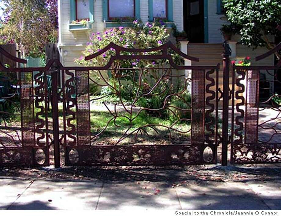 EBGATES07_Fence for EBGATES07; A metal fence by Emeryville artist Vicki Jo Sowell in front of a home in West Berkeley depicts animals found in the neighborhood. Courtesy of Jeannie O'Connor / Special To The Chronicle Photo: Courtesy Of Jeannie O'Connor