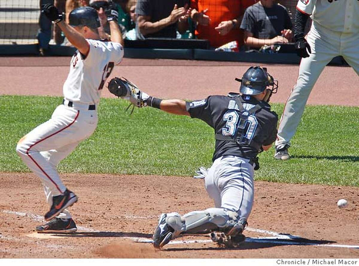 Giants Omar Vizquel beats the tag at home plate by Marlins Miguell Olivo. Single by San Francisco's 39-Guillermo Rodriguez scores two runs, 5-2 Giants. San Francisco Giants vs. Florida Marlins. The San Francisco Giant Barry Bonds is just 1 home run away from a tie with the all time home run record set by Hank Aaron at 755. Photographed in, San Francisco, Ca, on 7/29/07. Photo by: Michael Macor/ The Chronicle