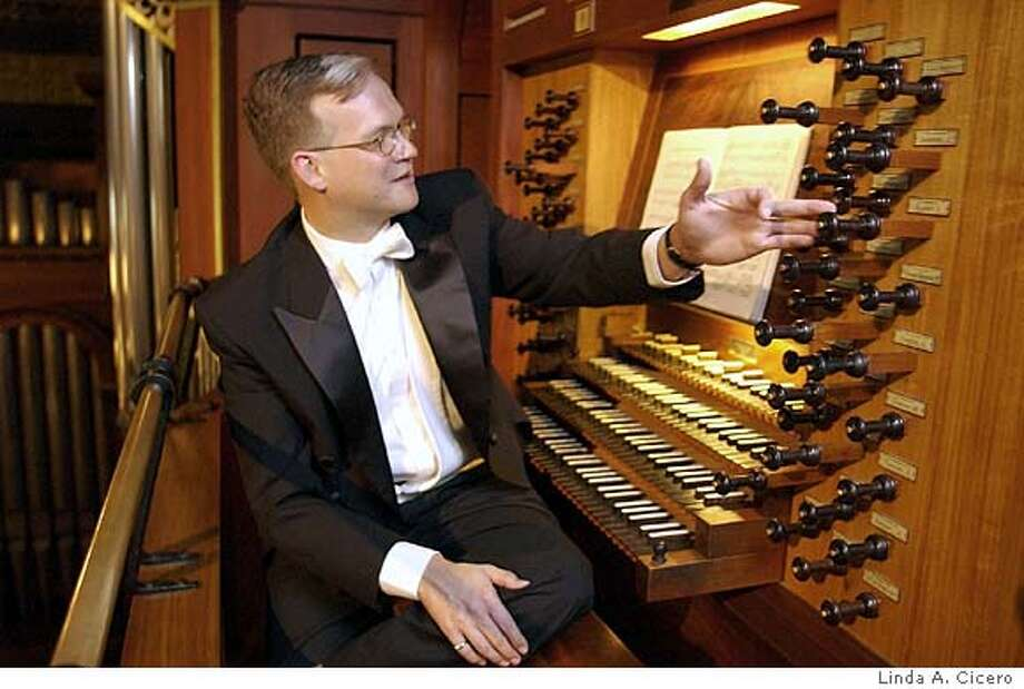 PNCHAT07_Stanford_Organist.jpg for PNCHAT07; Stanford University organist Robert Huw Morgan in the upstairs gallery of Memorial Church.  �� Linda A. Cicero / HO Photo: Linda A. Cicero