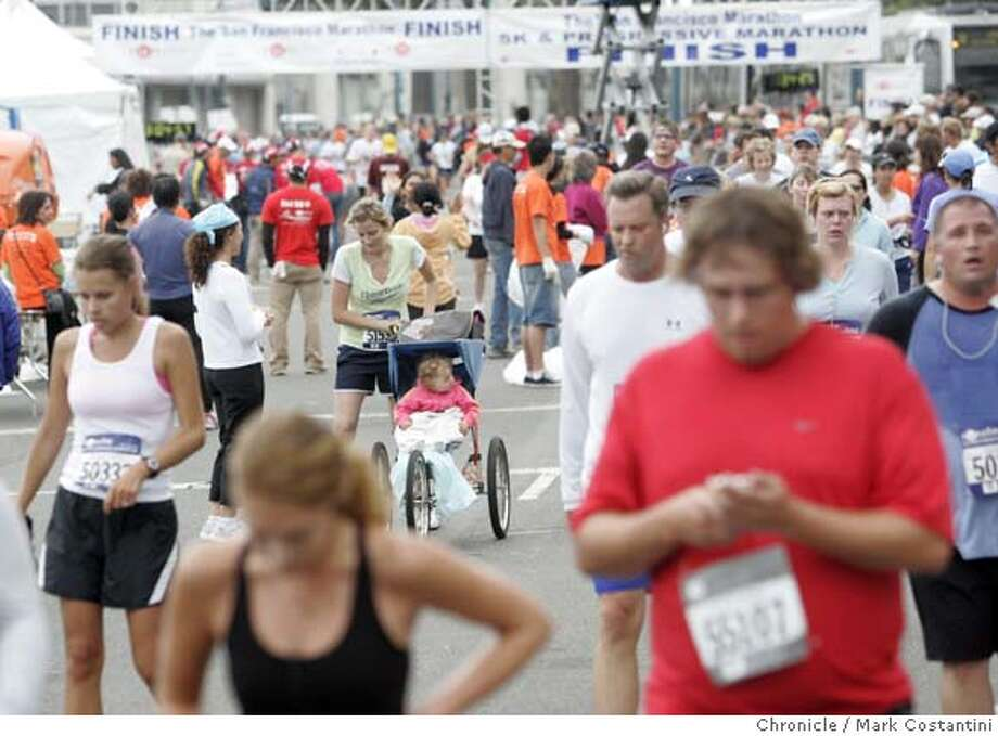 Crowd of runners after finishng the San Francisco Marathon Photo: Mark Costantini / S.F. Chronicle Photo: Mark Costantini