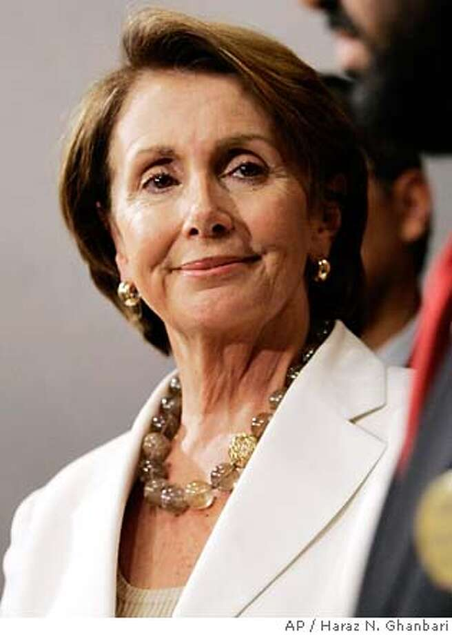 Speaker of the House Nancy Pelosi, D-Calif., left, listens to Rep. Al Green, D-Texas, during a news conference on Capitol Hill, Friday, July 27, 2007, in Washington. (AP Photo/Haraz N. Ghanbari) Photo: Haraz N. Ghanbari
