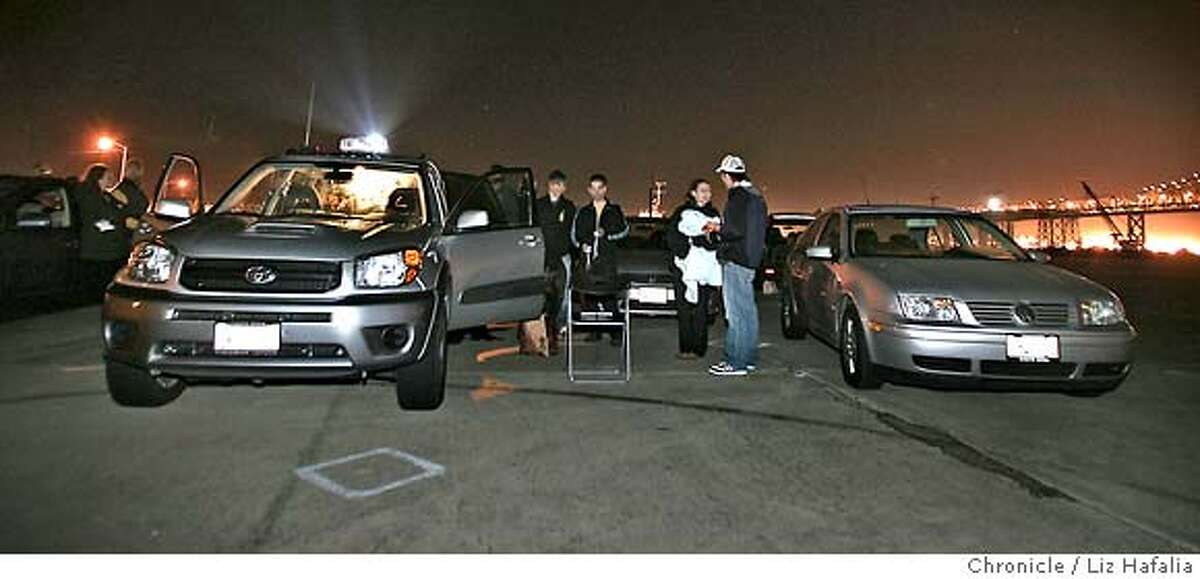 MOBMOV_002_LH_.JPG Drive-in movies being shown in an abandoned parking lot. Moviegoers playing digital games from the projection equipment on van at left, during intermission. Liz Hafalia/The Chronicle/Treasure Island/7/20/07 ** cq �2007, San Francisco Chronicle/ Liz Hafalia MANDATORY CREDIT FOR PHOTOG AND SAN FRANCISCO CHRONICLE. NO SALES- MAGS OUT.