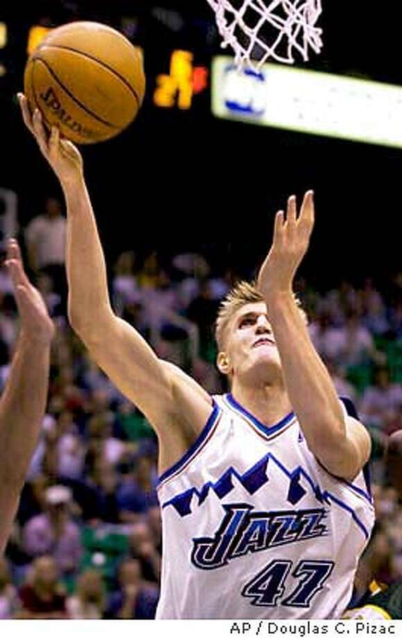 ** ADVANCE FOR WEEKEND EDITIONS, NOV. 8-9 ** Utah Jazz forward Andrei Kirilenko lays one in against the Seattle SuperSonics during the third quarter of their preseason game Saturday, Oct. 11, 2003, in Salt Lake City. (AP Photo/Douglas C. Pizac) Photo: DOUGLAS C. PIZAC