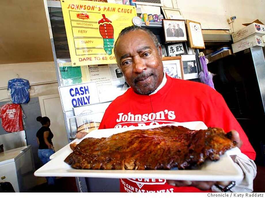 ".jpg  SHOWN: Joe Johnson holds a slab of ribs sauced with with ""Thermo Nuclear Sauce."" Note behind Joe is the Johnson's Pain Gauge. For Bonnie Wach Today's Special column. Johnson's Barbeque at 2646 San Bruno Ave., SF. Thursday, July 19, 2007.  (Katy Raddatz/The Chronicle)  **Thermo (NOT Thermal) is the correct spelling! Joe Johnson Mandatory credit for the photographer and the San Francisco Chronicle. No sales; mags out. Photo: Katy Raddatz"