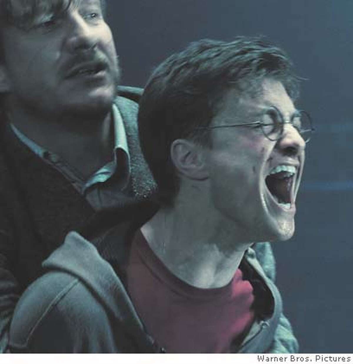 """DAVID THEWLIS as Remus Lupin and DANIEL RADCLIFFE as Harry Potter in Warner Bros. Pictures' fantasy """"Harry Potter and the Order of the Phoenix.""""PHOTOGRAPHS TO BE USED SOLELY FOR ADVERTISING, PROMOTION, PUBLICITY OR REVIEWS OF THIS SPECIFIC MOTION PICTURE AND TO REMAIN THE PROPERTY OF THE STUDIO. NOT FOR SALE OR REDISTRIBUTION. Ran on: 07-10-2007 Imelda Staunton plays the petty Dolores in Harry Potter and the Order of the Phoenix. Ran on: 07-29-2007 John Wayne in The Shootist: Give him a break."""