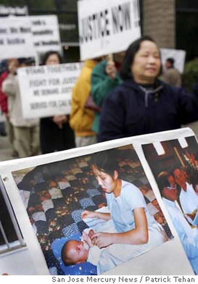 Members of the Coalition for Justice and Accountability gather outside San Jose (Calif.) City Hall, Wednesday morning, Nov. 5, 2003, to protest the police shooting of Cau Bich Tran, pictured in family snapshot. An open grand jury on Oct. 30 cleared San Jose police officer Chad Marshall of criminal wrongdoing in the fatal shooting of Tran, 25, a mentally ill Vietnamese woman who appeared to threaten bystanders with an Asian vegetable peeler. (AP Photo/San Jose Mercury News, Patrick Tehan) Photo: PATRICK TEHAN