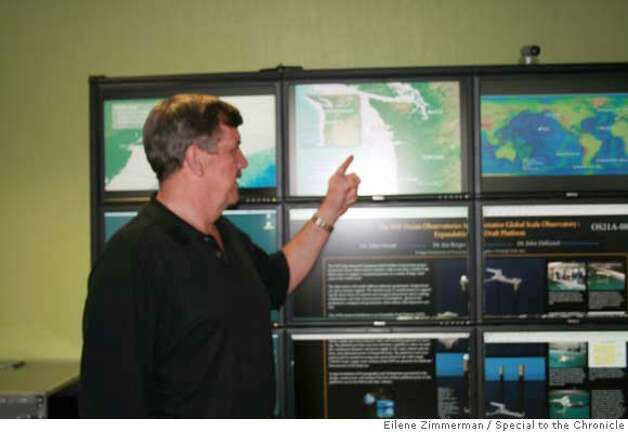 OCEAN29.01  UCSD Prof. John Orcutt oversees the Ocean Observatories Initiative. In the workspace at Calit2 at UCSD in La Jolla., points to where the ocean buoys will be placed. BY EILENE ZIMMERMAN/SPECIAL TO THE CHRONICLE Photo: EILENE ZIMMERMAN