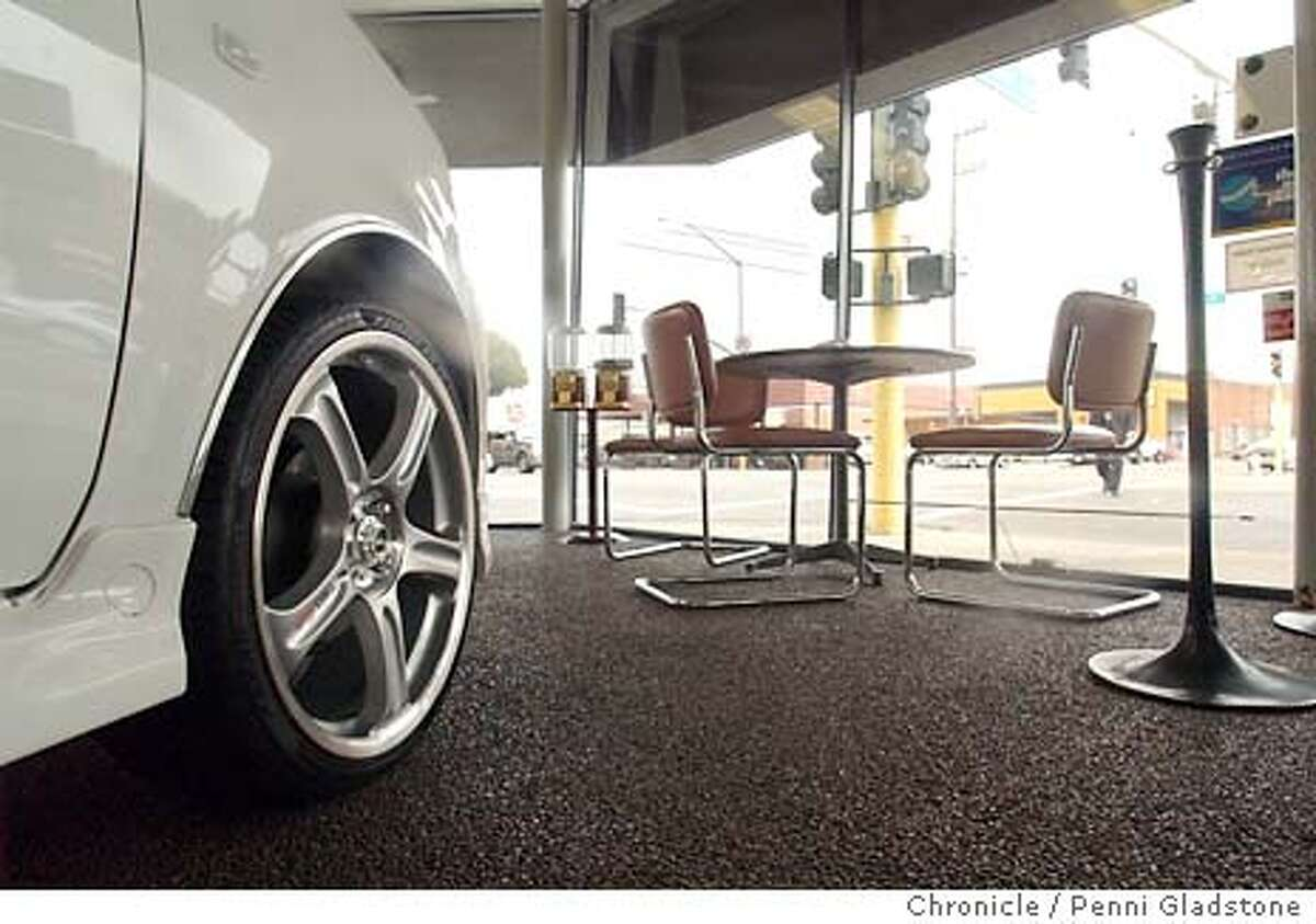 CARS002_pg.jpg The empty showroom...empty table and seats looking out onto the street with a Scion at left. This is at Ron Good Toyota. auto sales in CA declined 2ice as much as the rest of the nation in Oct. 11/5/03 in Alameda. PENNI GLADSTONE / The Chronicle
