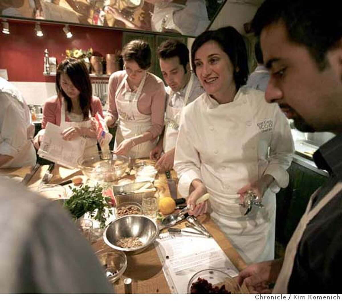 .JPG For our feature on offbeat food-related businesses we visit Sur La Table on Maiden Lane where the summer interns from Protiviti join in a team-building cooking class. Chef Bibby Gignilliat, second from right, teaches as students prepare their dishes. Photo by Kim Komenich/The Chronicle **Bibby Gignilliat MANDATORY CREDIT FOR PHOTOG AND SAN FRANCISCO CHRONICLE. NO SALES- MAGS OUT.